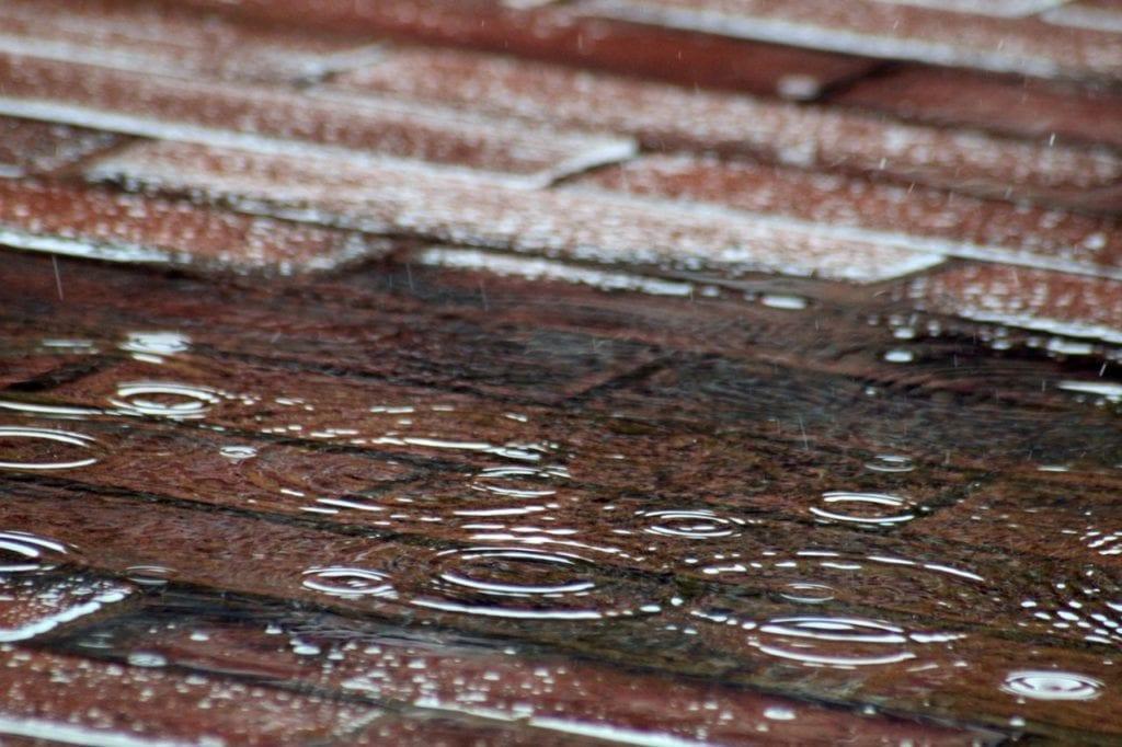 Raindrops On Red Brick Pavement